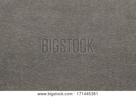 background and texture of knitted or woolen fabric of monotonous beige color