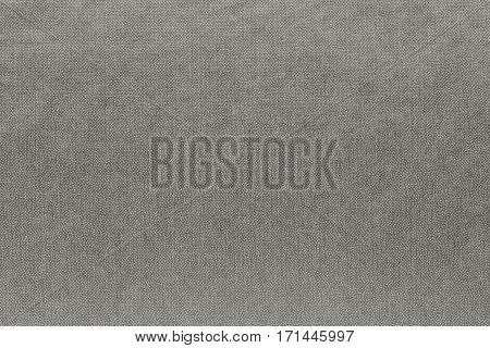 abstract background and speckled or mottled texture of fabric or textile material of pale beige color