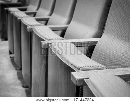 Black and white image/  Empty rows of armchairs in hall, Business concept