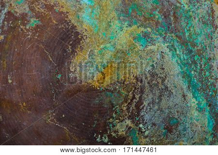 Abstract background. Copper, emerald, brown, yellow. Retro. Corrosion on copper pelvis