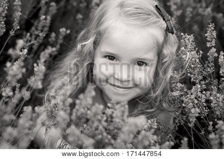 portrait smiling toddler girl in lavender field