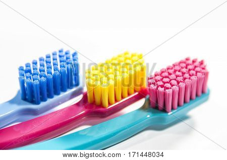 Colorful professional soft toothbrushes with lot of bristles in straight cut on white background.