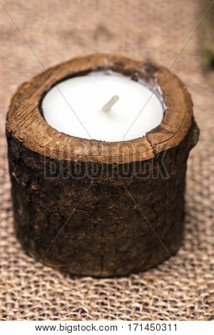 Candle In A Wooden Candlestick On A Romantic Background
