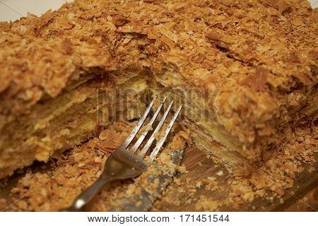 Homemade Cake Napoleon on wooden background. Closeup