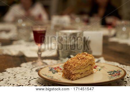 Homemade Cake Napoleon on festive table. Closeup.