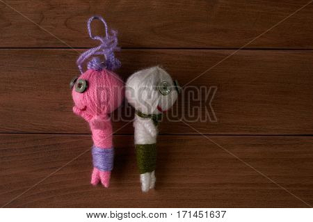 Cute Little Voodoo Dolls on wooden background.Top view