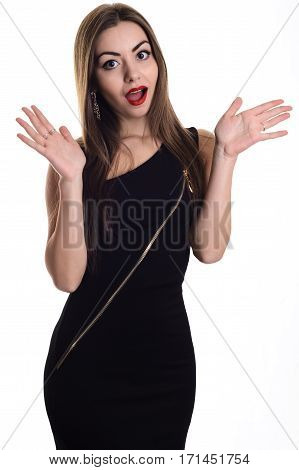 Stylish Girl In Black Evening Dress Standing With Her Mouth Open In Surprise, And Hands Outstretched