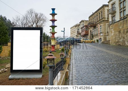 Vertical blank billboard on the beautiful city street