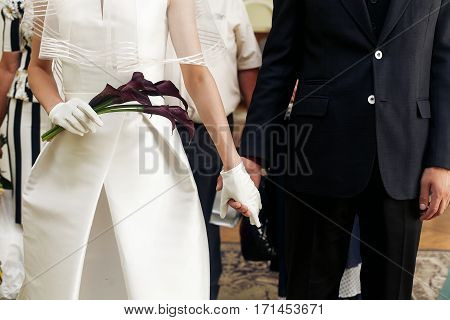 Luxury Wedding Couple Holding Hands Closeup With Calla Bouquet In Morning Before Official Registrati