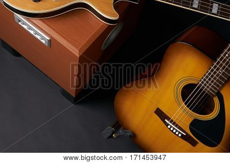 Electric bass guitar and acoustic guitar. Close up.Top view.