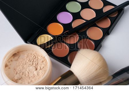 Make up professional cosmetics palette with eyeshadow and brushes isolated on white. Professional make-up tools closed-up.Top view with copy space.