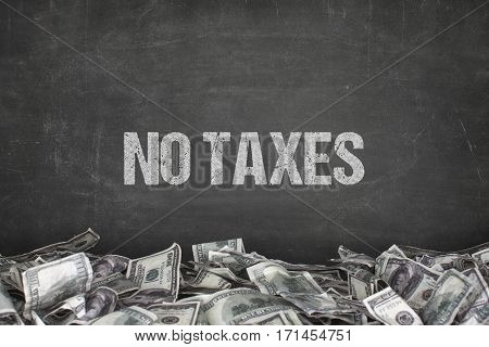 No taxes text on black background with dollar pile