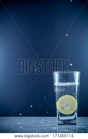 Slice Of Lemon Drops In A Glass Of Water