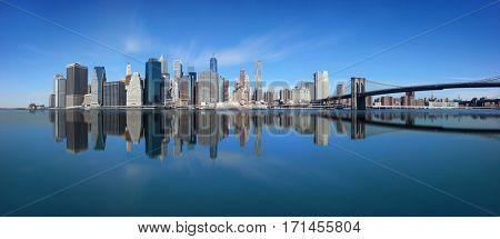 Brooklyn Bridge and downtown Manhattan skyline reflection in New York City