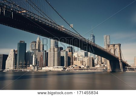 Below Brooklyn Bridge with downtown Manhattan skyline in New York City