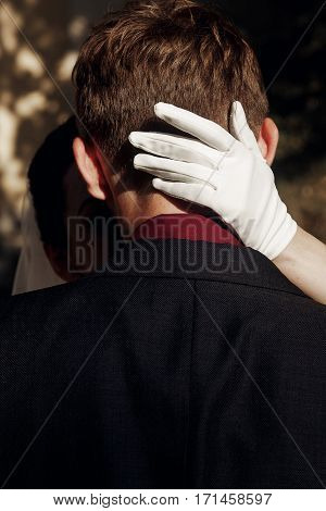 Elegant Gorgeous Bride Hugging Stylish Groom. Hand In White Glove On Man Head. Unusual Luxury Weddin