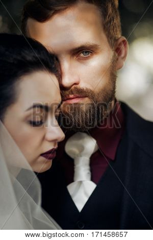 Elegant Stylish Groom Looking At Gently Gorgeous Bride In Soft Light. Unusual Luxury  Wedding Couple