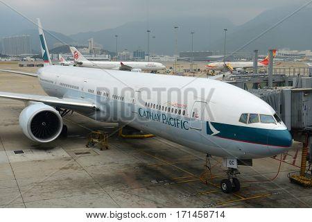 HONG KONG - NOV. 9, 2015: Cathay Pacific Boeing 777-300 at the gate in Hong Kong International Airport (Chek Lap Kok Airport).