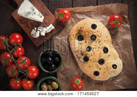 Italian focaccia bread similar to pizza with black olive slices