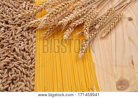 Wholemeal Pasta Fusilli From Organic Grain, Spaghetti From White Flour And Ears Of Wheat On A Rustic