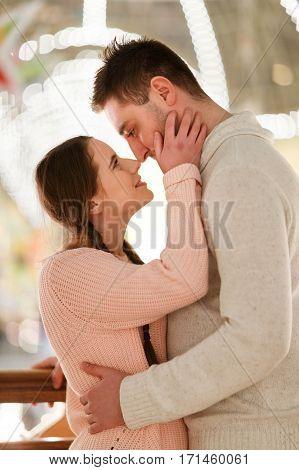 Loving couple on romantic photo against background lights