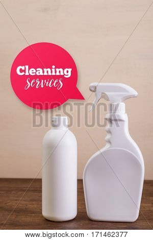 Mock-up plastic bottles. Cleaning services speech bubble. Shampoo and washing spray cleaner. Mockup design for branding. Front view. Wooden rustic board.