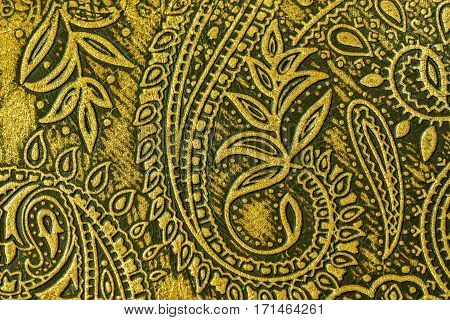 Close-up texture of fragment genuine leather with an abstract ornament