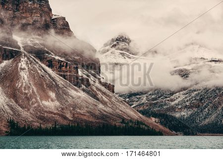 Bow Lake with snow and fog mountain in Banff National Park, Canada.