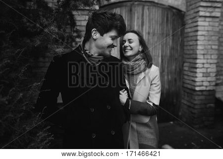 Stylish Couple Having Fun And Laughing In Autumn Park. Man And Woman Smiling, Joyfull Moments Of Tru