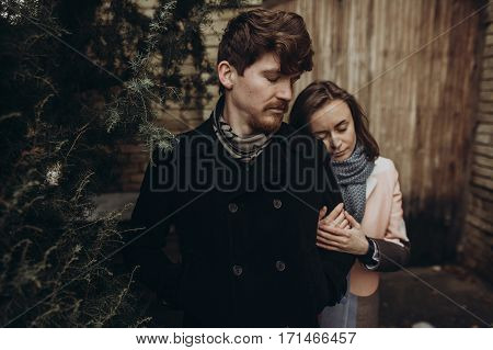 Romantic Stylish Couple Hugging Gently In Autumn Park. Man And Woman Embracing, Showing True Feeling