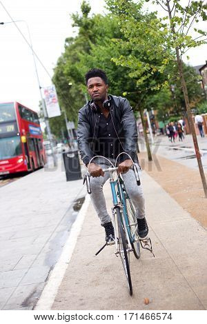 a young man cycling to work in london