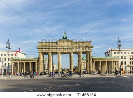 Brandenburg Gate  In Berlin With The Fernsehtower With People And Cars