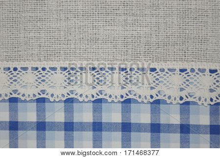 Beautiful lace and blue tartan textile texture background