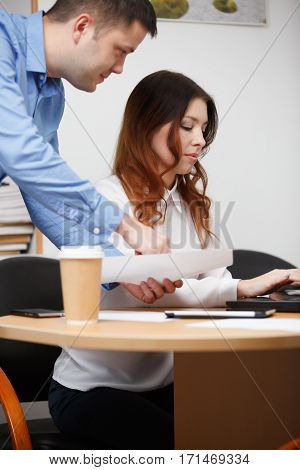 Young employees on financial sector work at computer