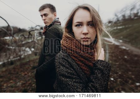 Stylish Hipster Couple Posing In Windy Autumn Park. Beautiful Woman Portrait. Space For Text. Creati