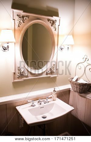 white washstand with large oval mirror in vintage style