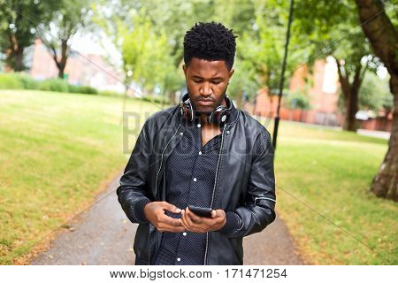 a young man checking his phone messages