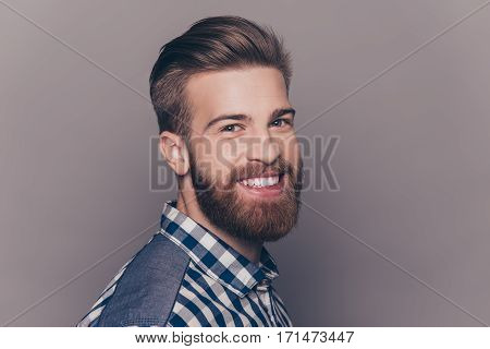Side View Portrait Of Cheerful Stylish Man With Beaming Smile
