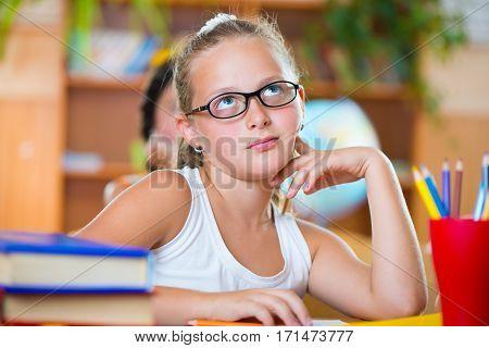 Cute Girl In Classroom At School