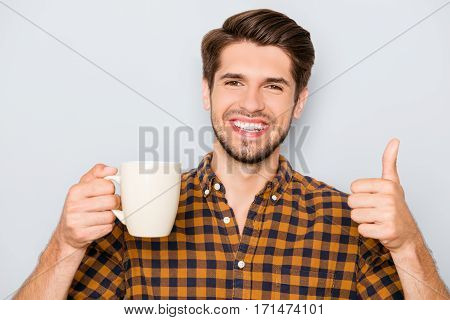 Happy Cheerful Man With Cup Of Tea Gesturing Like
