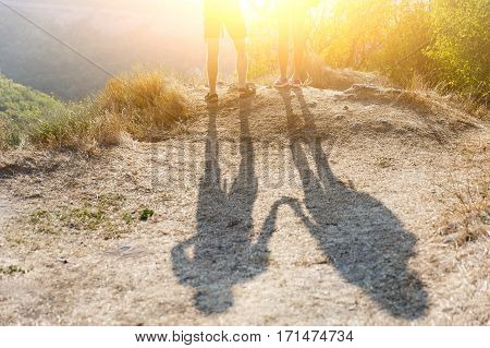 Shadow of mens on mountain hill in day
