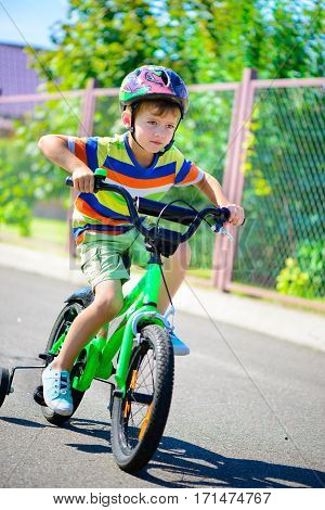 Cute Little Boy In Bicycle
