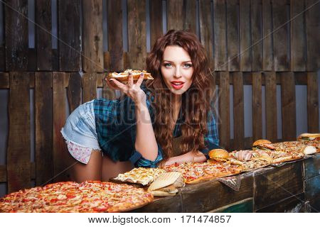Girl with piece of pizza promotes fast food. Fastfood advertise
