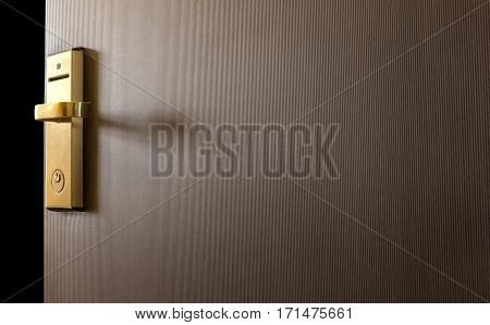 the part of wooden door with metal handle