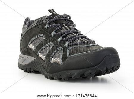 Close up view of a modern black man sports shoes isolated on a white background.
