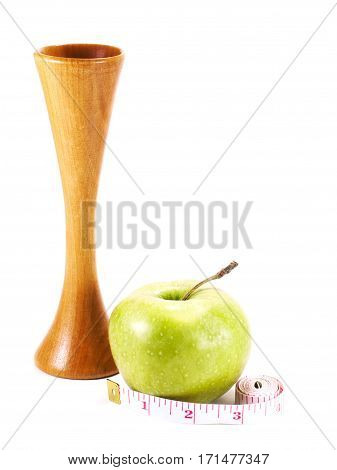 Stethoscope and green apple measuring tape on a white background