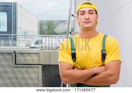 Repairman in coveralls in DIY concept