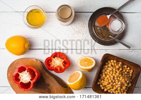 Ingredients for hummus preparation ob the white wooden table horizontal