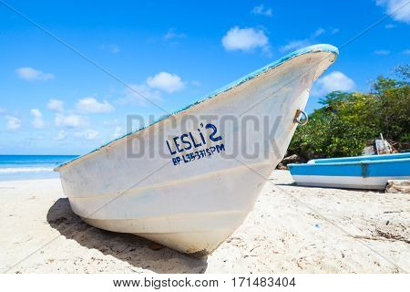 White Pleasure Boat Lays On Sand