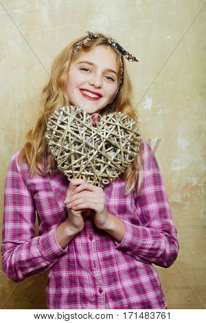 Happy Pretty Girl With Wicker Heart For Valentines Day